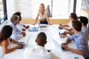 Businesswoman presenting to colleagues at a meeting