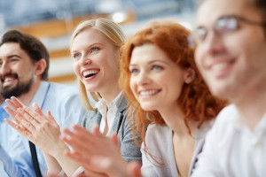 picture of people clapping as they learn to lead