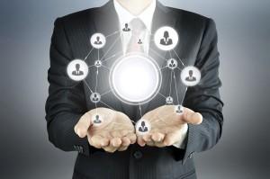Hands carrying a matrix organization